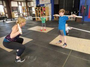 Kyla teaching the squat
